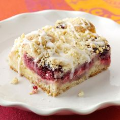 Lemon-Raspberry Streusel Cake Recipe -Buttery almond streusel tops the luscious, raspberry-studded lemon cream in these very special bars. If desired, an icing made with 1 cup powdered sugar and 3 teaspoons lemon juice may be drizzled over the cooled bars.—Jeanne Holt, Saint Paul, Minnesota