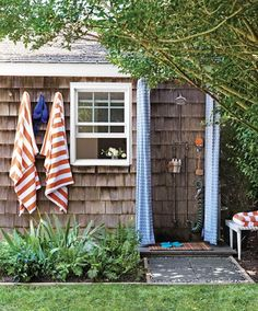 Good idea for an outdoor shower: A shower curtain, a spray hose, and good drainage. (from Martha Stewart Living June 2011)