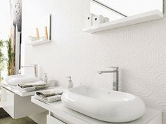 Zoe Blanco tile from Porecelanosa USA. The look of anaglypta wallpaper, but better. Sculptural, washable beauty.