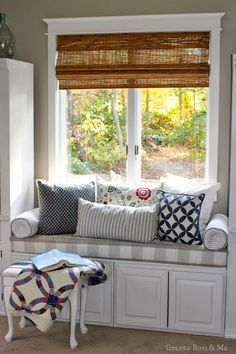 DIY window seat made with off the shelf kitchen cabinets with no sew buffalo check fabric in master bedroom via www.goldenboysandme.com