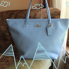 """Large blue tote Summer Clearance NWT F34103 Coach Leather Street Zip Tote Shoulder Handbag - Light blue Color  100% authentic Coach bag with tag.  Retail Price $295  Inside zip, cell phone and multifunction pockets Zip-top closure Fabric lining Handles with 9"""" drop Silver hardware Flat bottom Approx.: 16 1/2"""" at the top (L) x 10 1/2"""" (H) x 7"""" (W).   Was 199 Coach Bags Totes"""
