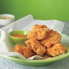 """Baked Chicken Nuggets - These are baked, so you can enjoy them guilt-free. A three-step breading method -- coating """"REAL"""" chicken pieces in flour, egg, and breadcrumbs -- seals in moisture and gives a crisp crunch without a lot of added fat. Baked Chicken Nuggets, Chicken Nugget Recipes, Crispy Chicken, Healthy Chicken, Chicken Tenders, Coconut Chicken, Chicken Bites, Crusted Chicken, Chicken Breasts"""