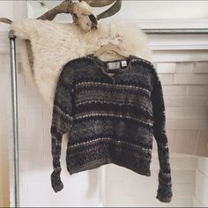 VINTAGE/ wool sweater ⱝ tribal pattern ⱝ long sleeve, knit sweater  ⱝ wool blend ⱝ vintage american eagle ⱝ thick and feels high quality ⱝ wooden button detail ⱝ fits xsmall or small ⱝ excellent condition   » I NO LONGER LOWER MY PRICES, BUT OFFERS ARE ABSOLUTELY WELCOMED  » UNLESS ITS FOR A BUNDLE, I WILL NOT RESPOND TO OFFERS IN COMMENTS   » I WILL MAKE A NEW LISTING FOR DISCOUNTED SHIPPING American Eagle Outfitters Sweaters