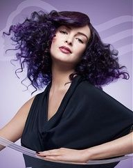A long black curly wavy coloured purple big-bouncy hold body curl hairstyle by Wella