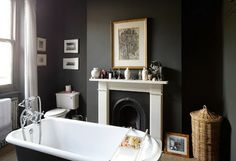 Clawfoot tub + fireplace + off-black walls = perfection