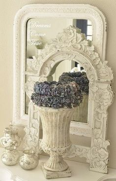 layered ornate #mirrors + floral.  Always a winning combination