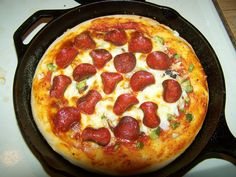 Deep Dish Cast Iron Skillet Pizza. The perfect Friday night dinner.