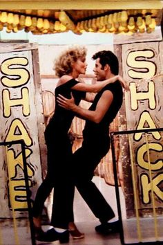 Grease starring Olivia Newton-John as Sandy Olsen and John Travolta as Danny Zuko gracious this still one of my ultimate favorite movies of all time! Grease 1978, Grease Movie, Danny Grease, Grease Play, Grease Dance, Danny Zuko, Iconic Movies, Old Movies, Sandy And Danny