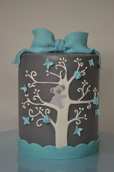 "This is my first barrel cake. It's 6"" round. It has ganache under the fondant (another first for me),  it is adorned in fondant hand cut accents and branches were piped on with royal icing."