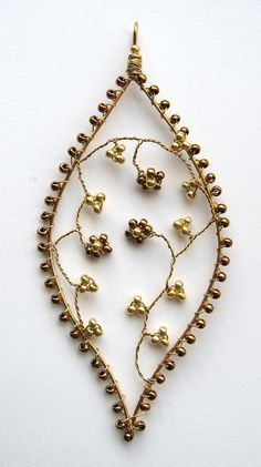 Apologies if everyone's had enough of these - I'm afraid I haven't yet!  Brass wire, with seed beads.