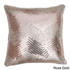 Add style to any space with the crackle chevron sequin throw pillow. Made from cotton and feather fill, this one of a kind decorative pillow is available in rose gold and silver.