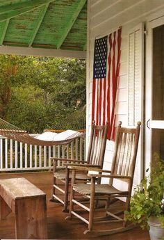 Flag + hammock + rockers = Rustic Farmhouse Porch From contentinacottage.blogspost.com #rockingchair