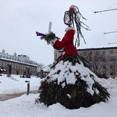 """""""Creative sculpture wearing an evergreen petticoat, flowing wooden hair tied back with the Quebec Carnival sash Quebec City, Tie Backs, Hair Ties, Sash, Evergreen, Carnival, Canada, Joy, Sculpture"""