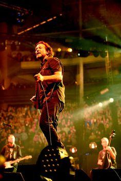 Description of . Pearl Jam lead singer Eddie Vedder stands on a speaker as he looks into the crowd.  (Pioneer Press: Sherri LaRose-Chiglo)