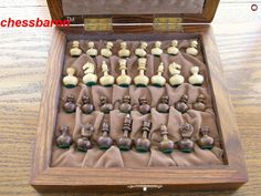 Weebles No Wobble! Tiny Combination Chess Set! Constructed in Golden Rosewood, this set is soooo cute. Remember the weebles - they wobble but don't fall down? Every little piece can be made almost horizontal, but just springs back into place. Case 8.5 inches Square. King 1.6 inches High, King Weigth 10g Get all your chess needs at ChessBaron.co.uk the UK's leading chess website with international shipping available!