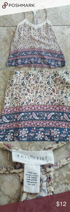 💕New Listing! Super cute paisley flowy tank Beautiful casual t-back with double straps, delicate lace detailing at the neckline, and an oh-so-pretty paisley print in cream, pink, and blue. The perfect light and airy top for spring and summer...so cute with cutoff shorts and canvas wedges. 100% rayon.   See pics 4 & 5 where seam came loose on upper back and was resewn. Not noticeable unless you are looking for it. Otherwise EUC! Full Tilt Tops Tank Tops