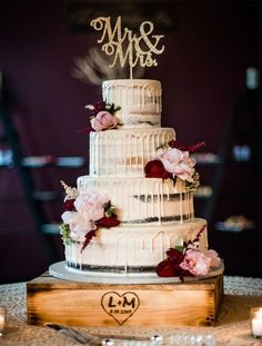 Four tier semi naked wedding cake with burgundy and blush flowers #weddingcake #cake #seminakedcake #fourtier