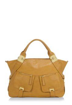 Magic Kingdom - this bag has a matte finish, it isn't shiny. Nice, rich tan bag.