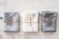 Set of 3 handmade linen towels:  1 bluish grey washed linen towel; 1 white washed linen towel; 1 silver washed linen towel;  The set of kitchen towels - 3 x about 50 cm x 70 cm;  Our items are made of washed linen fabric, specially woven for us by our local linen manufacturers. The procedure of making these items takes time and effort, cause the items are double washed once they are made. Only after such process we reach extra softness and natural wrinkles. Simply washed linen towels…
