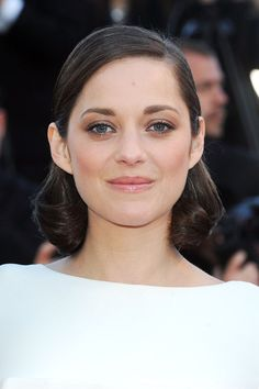 Cannes Film Festival 2013: Marion Cotillard showcased polished hair and make-up at the premiere of The Immigrant: her eyes were carefully defined with kohl liner, her lips left bare but for a slick of gloss and her hair was curled into a sleek bob.
