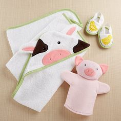 This 3-piece cow, chicken and pig bath set will keep baby entertained and clean.