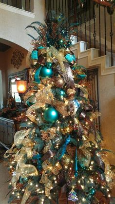 100 Festive Christmas Tree Ideas that'll make the Christmas Cheer even more Vibrant - Hike n Dip - - Thinking about Christmas Trees? Why not take a Look at this collection of festive Christmas tree ideas that will give you plenty of unique ideas. Peacock Christmas Tree, Beautiful Christmas Trees, Christmas Tree Themes, Blue Christmas, Winter Christmas, Christmas Tree Decorations, Turquoise Christmas Decorations, Christmas Photos, Christmas Ideas