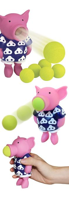 Pig Popper // Just squeeze the pig's belly to launch the soft foam balls. The harder you squeeze, the farther it shoots up to 20 feet. #toy_design