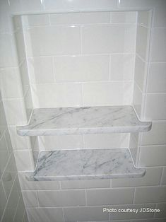 Marble shelf with subway tile niche