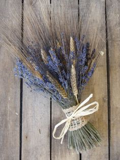 This beautiful and romantic bouquet is made from bearded wheat and dried french lavender. The stems are wrapped with a burlap ribbon and tied with a