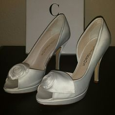 Caparros Ivory Heels Ivory 4 inch heels by Caparros. There's some black scoff marks on the right shoe. Likely to wash off easily. Caparros Shoes Heels