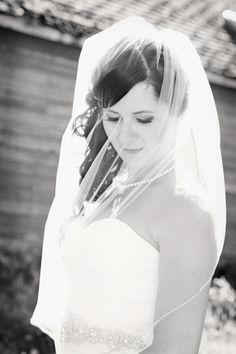 Bridal portrait with veil on a farm.  www.allypapko.com