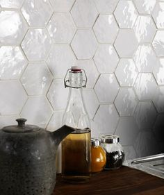'We've seen hexagonal tiles pop up in the bathroom, and now they're having their time in the kitchen. Geometric shapes such as these can add visual interest either in a random pattern or, as laid here, in a repeating pattern' - Houzz. Bisquette Handcrafted Hexagon Tile by Toppstiles