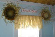 use an old hula skirt for the windows either for the jungle theme for girl or pirate/beach theme for boy!