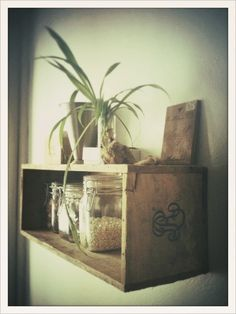 Good ideas for using vintage boxcrates and other wooden boxes as storage/shelves.