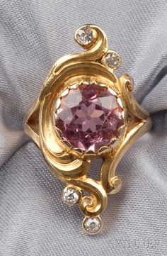 Art Nouveau 14kt Gold, Pink Tourmaline, and Diamond Ring, bezel-set with a circular-cut pink tourmaline measuring approx. 9.50 x 5.40 mm, in a scrolling mount with old European-cut diamond melee accents