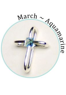 "Compelling Creations, Inc. - This beautiful cross holds a genuine crystal at its center.   The aquamarine is birthstone crystal for March.    Celebrate a baptism, birthday, confirmation, first communion, or buy your favorite colors to match different outfits. 3/4"" long.       Available in the  Share It! rhodium plated line."