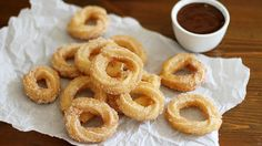 Deep-fried batter tossed in cinnamon-sugar and dipped in warm, chocolaty peanut butter sauce.