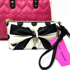 Betsey Johnson Double Entry Bow Wristlet/Wallet Everyone needs one great wristlet/wallet and this one is ultra chic! It's perfect- phone fits both in large zip pouch or middle slip pocket w/ extra room for keys! Has a detachable strap w/ cute bow which makes it very versatile. Signature logo on goldtone hardware and zipper pouch has signature fabric lining. Shinny gold color interior with multi slip pockets, 8 credit card slots and ID. Faux cream/black leather w/ bow and polka dots! So cute…