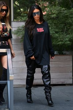 Hopes he calms down: Kim Kardashian backed her rapper-turned-designer husband by wearing one of his designs Thursday as insiders claim she's 'annoyed' by what's happened
