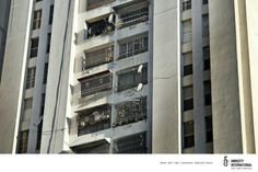 Print advertisement created by JWT, Venezuela for Amnesty International, within the category: Public Interest, NGO. Amnesty International, Multi Story Building, Photo Wall, Windows, Frame, Creative, Home Decor, Picture Frame, Photograph