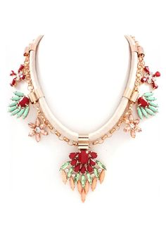 I love statement necklaces with more conservative necklines.  (Which is not to say that they don't rock with a more daring neckline because they do.)