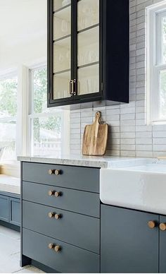 Blue and black cabinets with glass front