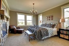 Loves: nail head trim headboard, patterned quilt with shams, solid color pintuck comforter with shams