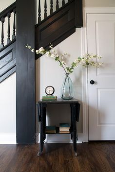 New spindles were custom created to match the old ones. With the dividing wall removed, some of the former elegance was returned to the foyer and staircase.