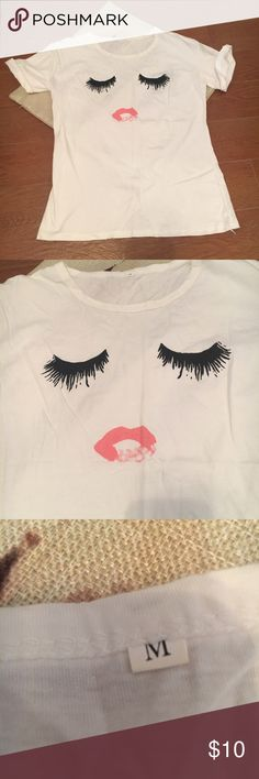 Makeup Inspired T Shirt Eyelashes and Lipstick M ADORABLE boutique style T Shirt, perfect for makeup lovers! Tag Size Medium but looks like a small. Tops Tees - Short Sleeve
