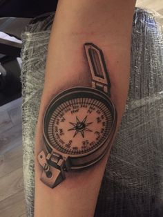 Military compass tattoo by Nick Westfall start of sleeve.