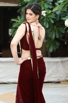 Zareen Khan looking ravishing in a maroon velvet & net saree | Etsy Mode Bollywood, Indian Bollywood Actress, Bollywood Actress Hot Photos, Bollywood Fashion, Bollywood Stars, Beautiful Girl Indian, Most Beautiful Indian Actress, Dress Indian Style, Indian Dresses