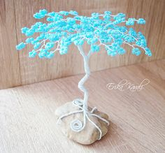 Beaded blue wire tree sculpture with sky blue leaves