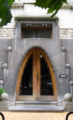 Brussels, Belgium This is a fabulous doorway and if the rest of the building talks the language of Art Nouveau then I would not be surprised. This is, however, a good example of the early Art Deco style.