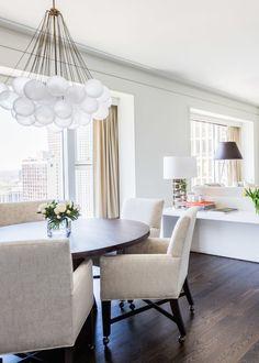 Sleek and modern dining room: http://www.stylemepretty.com/living/2015/08/26/a-chicago-pied-a-terre-home-tour/   Photography: Alyssa Rosenheck - http://alyssarosenheck.com/